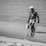 Water to clean his Catch, at Chethy Fishing Harbour, Kerala